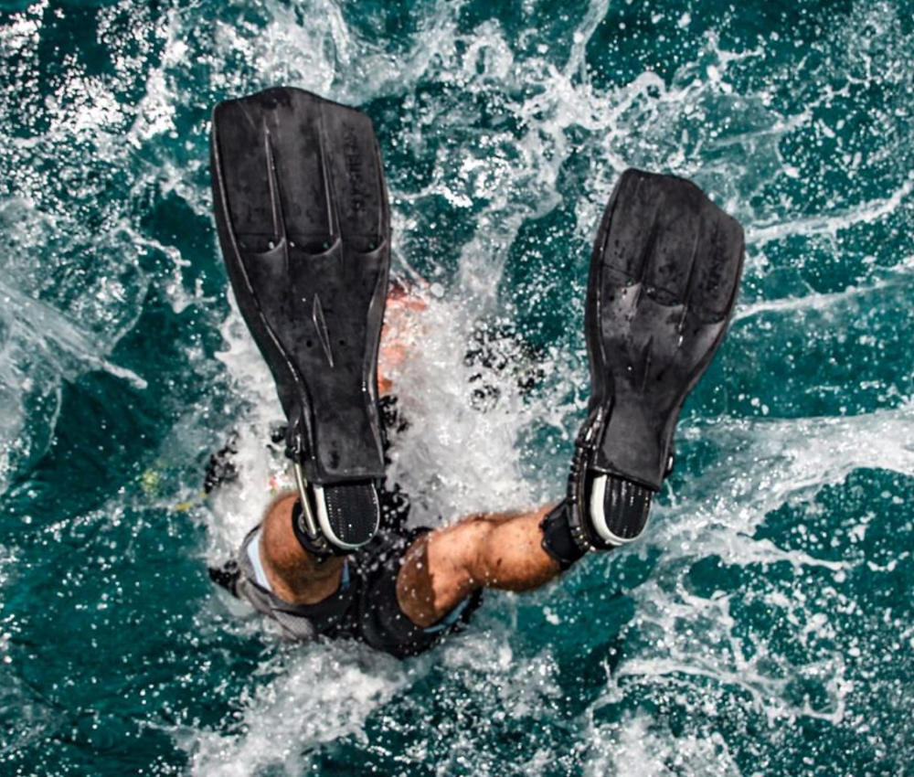 Diver backrolls in the water